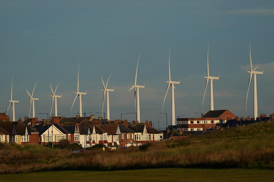 An offshore wind farm towers over homes in Redcar, England. Prime minister Boris Johnson wants the UK to become the 'Saudi Arabia of Wind Power'. Photo: Ian Forsyth/Getty Images
