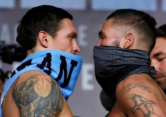 Oleksandr Usyk (L) and Tony Bellew go head to head during their weigh-in on Nov. 9, 2018 in Manchester, Britain. (Reuters)