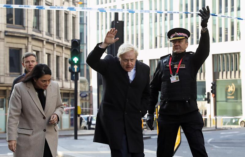 (left to right) Home Secretary Priti Patel, Prime Minister Boris Johnson and Commissioner of the City of London Police Ian Dyson attend the London Bridge crime scene in central London after a terrorist wearing a fake suicide vest who went on a knife rampage killing two people, was shot dead by police.