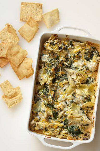 """<p>Any snack that involves hot, bubbling cheese is a winner in our eyes.</p><p><span class=""""redactor-invisible-space""""><em><a href=""""https://www.goodhousekeeping.com/food-recipes/a14127/three-cheese-artichoke-dip-recipe/"""" rel=""""nofollow noopener"""" target=""""_blank"""" data-ylk=""""slk:Get the recipe for Three-Cheese Artichoke Dip »"""" class=""""link rapid-noclick-resp"""">Get the recipe for Three-Cheese Artichoke Dip » </a></em></span></p>"""