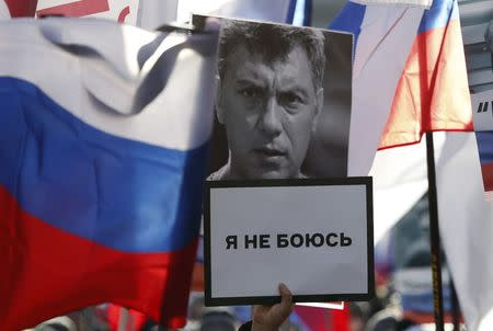 FILE PHOTO: A participant carries a placard, which reads 'I'm not afraid', during a rally in memory of Russian opposition politician Boris Nemtsov on the first anniversary of his murder in Moscow, Russia February 27, 2016. REUTERS/Sergei Karpukhin/File Photo