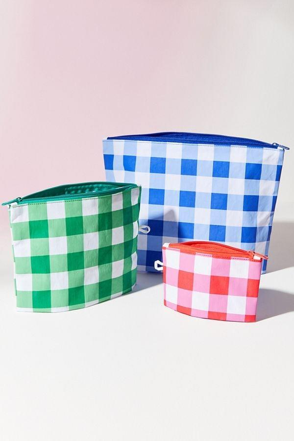 "<p>With this <a href=""https://www.popsugar.com/buy/Baggu-Go-Pouch-Set-477770?p_name=Baggu%20Go%20Pouch%20Set&retailer=urbanoutfitters.com&pid=477770&price=25&evar1=savvy%3Auk&evar9=46479463&evar98=https%3A%2F%2Fwww.popsugar.com%2Fsmart-living%2Fphoto-gallery%2F46479463%2Fimage%2F46479465%2FBaggu-Go-Pouch-Set&list1=shopping%2Ctravel%2Cbags%2Ctraveling%2Corganization%2Ctravel%20tips&prop13=api&pdata=1"" rel=""nofollow"" data-shoppable-link=""1"" target=""_blank"" class=""ga-track"" data-ga-category=""Related"" data-ga-label=""https://www.urbanoutfitters.com/shop/baggu-go-pouch-set2?category=SHOPBYBRAND&amp;color=060"" data-ga-action=""In-Line Links"">Baggu Go Pouch Set</a> ($25, originally $38), you can make multiple essential kits!</p>"