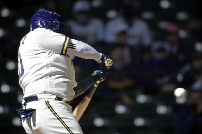 Milwaukee Brewers' Omar Narvaez hits an RBI single during the fifth inning of an Opening Day baseball game against the Minnesota Twins Thursday, April 1, 2021, in Milwaukee. (AP Photo/Aaron Gash)