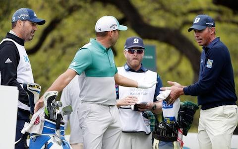 Sergio Garcia, second from left and Matt Kuchar, right, discuss on the eighth hole what had happened on the seventh green, during the Dell Technologies Match Play Championship golf tournament, Saturday, March 30, 2019, in Austin, Texas. Garcia had an 8-foot putt to win the seventh hole and left it 4 inches short, a frustrating miss. Worse yet was what followed. Such a tap-in typically is conceded in the Dell Technologies Match Play, and the Spaniard walked up and casually rapped it left-handed. The ball spun around the cup, and he picked it up and walked off the green, assuming he remained 1 down through seven holes. One problem: Matt Kuchar never formally conceded the putt - Credit: AP