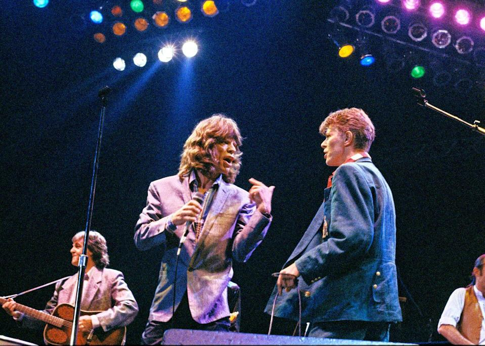 <p>Mick Jagger and David Bowie, with Paul McCartney on left, performing on stage at The Prince's Trust 10th Birthday Party at Wembley Arena, London, United Kingdom on 20th June 1986.</p>