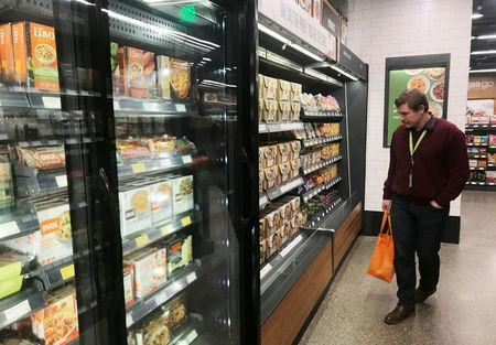 """A customer browses meal-kit options at Amazon's new """"grab-and-go"""" store in Seattle, Washington, U.S., January 18, 2018. Photo taken January 18, 2018. REUTERS/Jeffrey Dastin"""