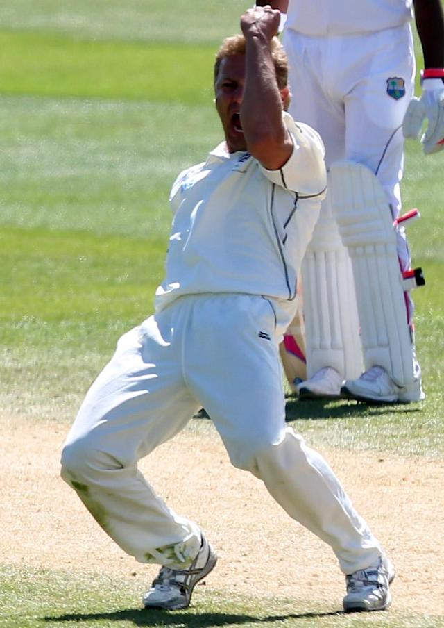 DUNEDIN, NEW ZEALAND - DECEMBER 06: Neil Wagner of New Zealand celebrates taking the wicket of Shivnarine Canderpaul during day four of the first test match between New Zealand and the West Indies at University Oval on December 6, 2013 in Dunedin, New Zealand. (Photo by Rob Jefferies/Getty Images)