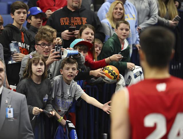 Fans greet Wisconsin guard Bronson Koenig (24) after a victory over Villanova in a second-round men's college basketball game in the NCAA Tournament, Saturday, March 18, 2017, in Buffalo, N.Y. (AP Photo/Bill Wippert)