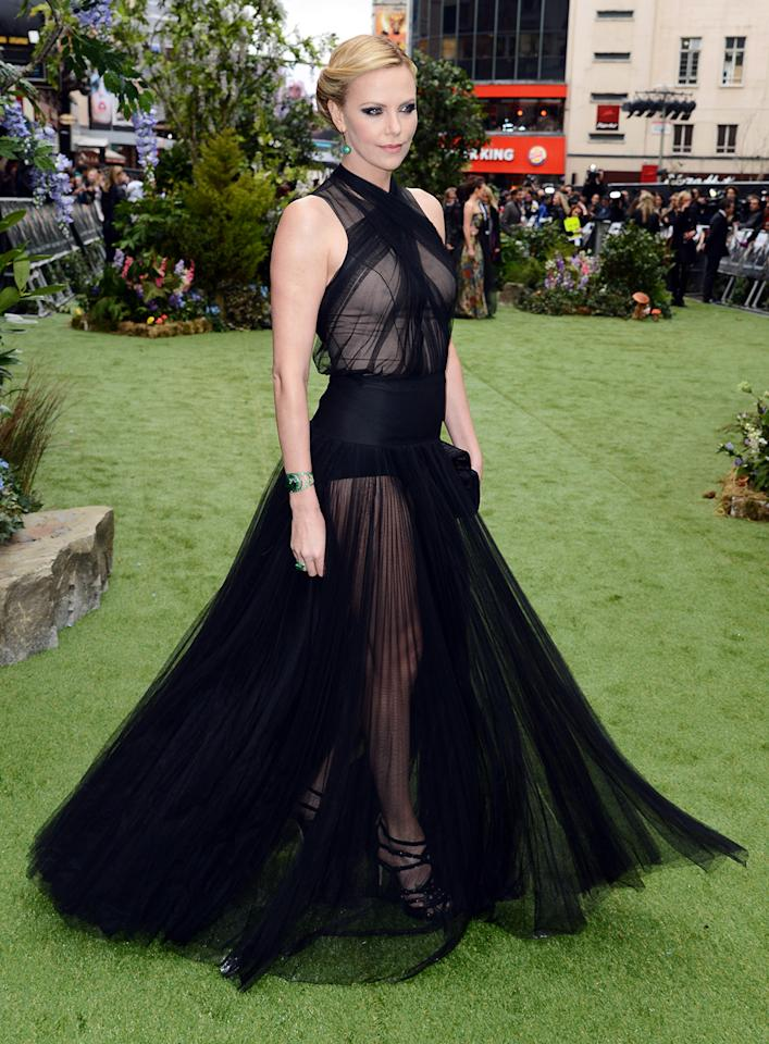 "Charlize Theron, a previous nominee for ""Young Adult,"" wore a see-through gown at the U.K. premiere of ""Snow White and the Huntsman."""