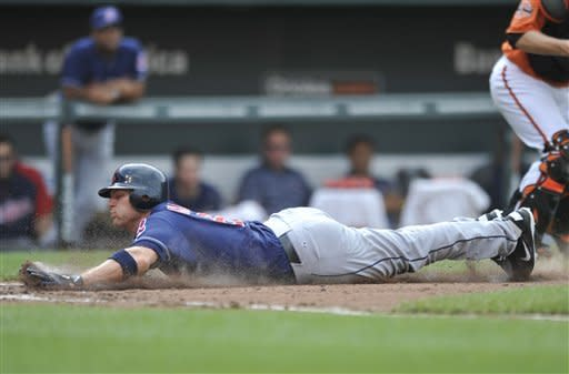 Cleveland Indians' Lou Marson slides safely into home on a single by Asdrubal Cabrera during the fourth inning of a baseball game Saturday, June 30, 2012 in Baltimore.(AP Photo/Gail Burton)
