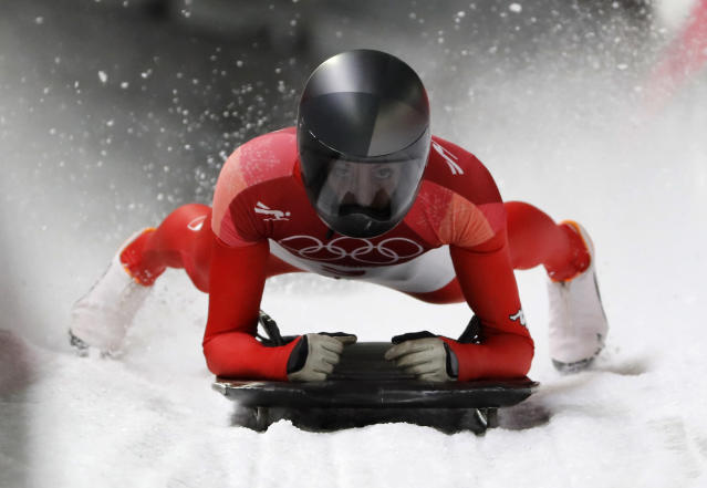 <p>Fourth placed Janine Flock of Austria brakes in the finish area after her final run of the women's skeleton competition at the 2018 Winter Olympics in Pyeongchang, South Korea, Saturday, Feb. 17, 2018. (AP Photo/Andy Wong) </p>