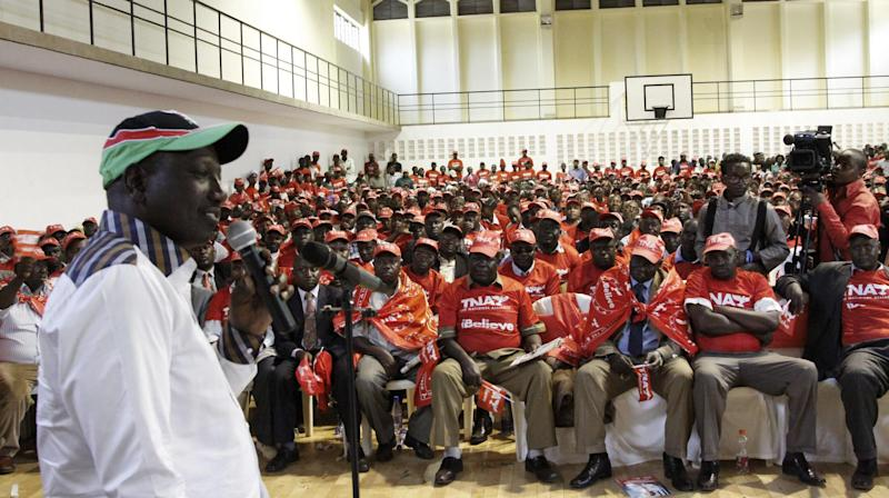 The United Republican Party's William Ruto addresses members of Matatu owners, drivers and conductors at the Kasarani sports complex in Nairobi, Kenya, Friday, Feb. 22, 2013, during the Jubilee Coalition presidential campaign. (AP Photo/Khalil Senosi)