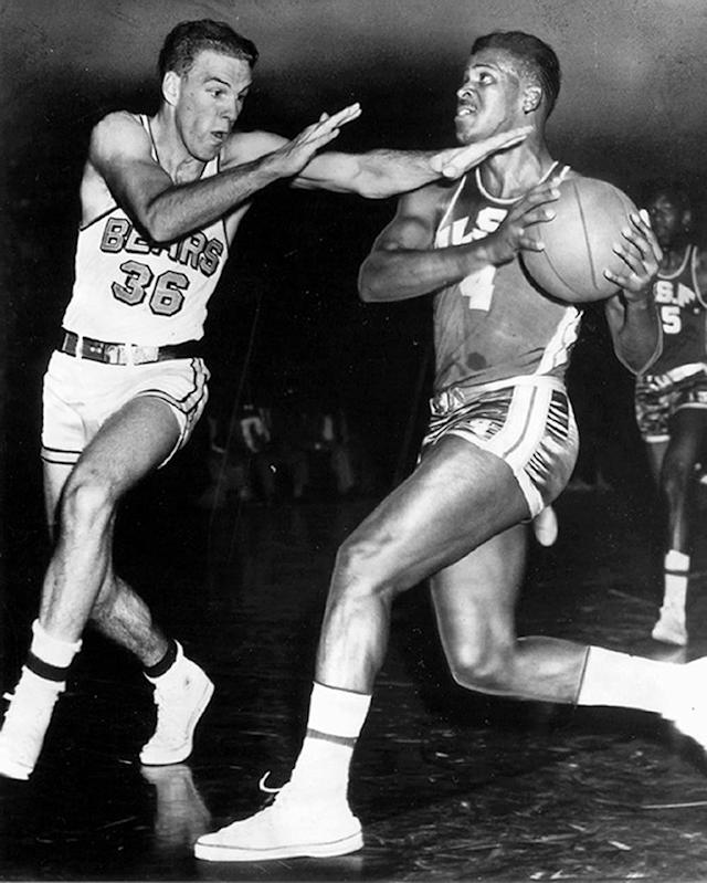 KC Jones of University of San Francisco Dons mens basketball team drives in for the lay-up at War Memorial Gym, in San Fransisco California, circa 1950.