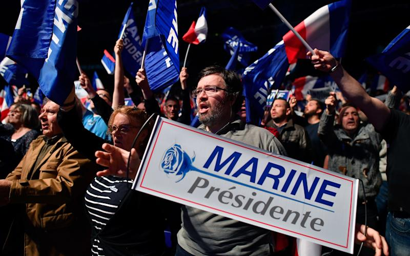 Far-Right supporters of Front National leader Marine Le Pen wave flags and banners at a campaign rally. Britain is watching the election closely - 2017 Getty Images