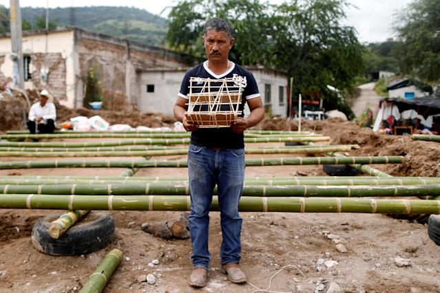 <p>Hector Guzman, 48, peasant and representative of the Municipal President in San Jose Platanar, holds the model of a new house for his father as he poses for a portrait after an earthquake in San Jose Platanar, at the epicentre zone, Mexico, September 28, 2017. Guzman is building his father a temporary house with bamboo reeds after it was badly damaged. (Photo: Edgard Garrido/Reuters) </p>