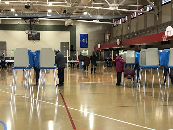 Voters cast their ballots on Tuesday, Nov. 3, 2020, at East Junior High School in Wisconsin Rapids.