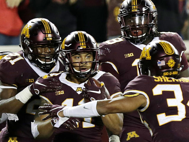 FILE - In this Saturday, Sept. 8, 2018, file photo, Minnesota's Antoine Winfield Jr. (11) is congratulated by teammates after intercepting a pass in the end zone during the fourth quarter of an NCAA college football game against Fresno State in Minneapolis. Winfield Jr. is out for the rest of the 2018 season after injuring his left foot in the Gophers Big Ten season opening loss at Maryland. (AP Photo/Andy Clayton-King, File)