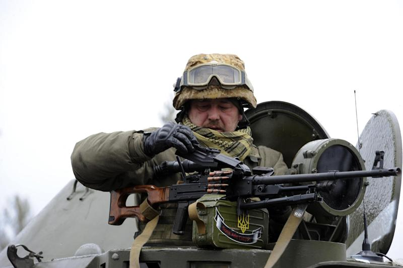 Ukrainian soldiers loads his weapon in the village of Bugas, in the eastern Ukranian Donetsk region on October 24, 2014