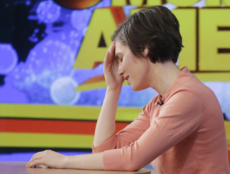 "Amanda Knox puts her hand to her forehead while making a television appearance, Friday, Jan. 31, 2014 in New York. Knox said she will fight the reinstated guilty verdict against her and an ex-boyfriend in the 2007 slaying of a British roommate in Italy and vowed to ""never go willingly"" to face her fate in that country's judicial system . ""I'm going to fight this to the very end,"" she said in an interview with Robin Roberts on ABC's ""Good Morning America."" (AP Photo/Mark Lennihan)"