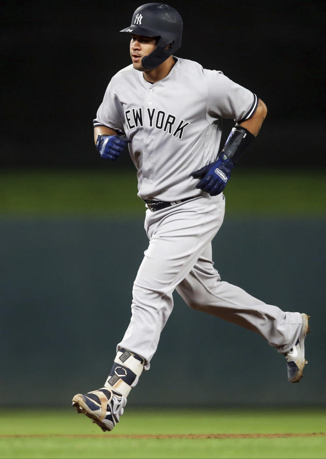 New York Yankees' Gary Sanchez runs the bases on a solo home run off Minnesota Twins pitcher Kyle Gibson in the sixth inning of a baseball game Monday, Sept. 10, 2018, in Minneapolis. (AP Photo/Jim Mone)