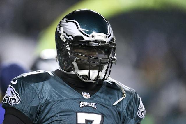 Philadelphia Eagles' Michael Vick warms up before an NFL wild-card playoff football game against the New Orleans Saints, Saturday, Jan. 4, 2014, in Philadelphia. (AP Photo/Julio Cortez)