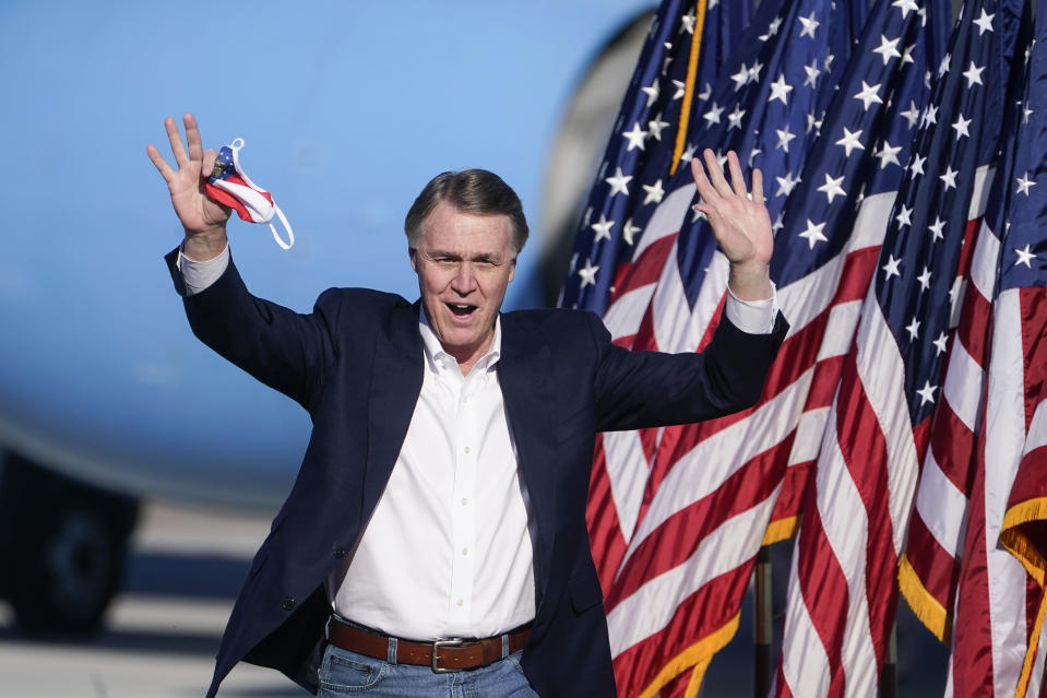"""Sen. David Perdue, R-Ga., arrives to speak before Vice President Mike Pence during a """"Save the Majority"""" rally on Thursday, Dec. 10, 2020, in Augusta, Ga. (AP Photo/John Bazemore)"""