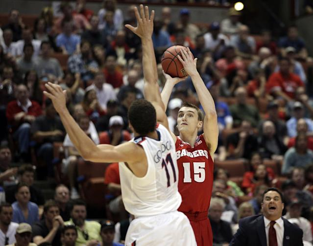 Wisconsin 's Sam Dekker (15) shoots past Arizona's Aaron Gordon (11) during the first half in a regional final NCAA college basketball tournament game, Saturday, March 29, 2014, in Anaheim, Calif. (AP Photo/Jae C. Hong)