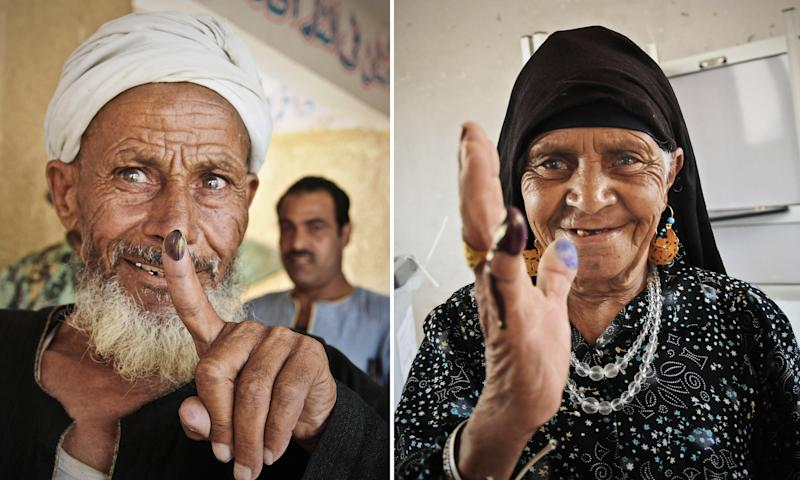 In this combo image made from two photos, an elderly Egyptian man, left, and a woman show their inked fingers after casting their votes at a polling station, in Giza, Egypt, Saturday, June 16, 2012. There's less enthusiasm for this weekend's presidential runoff in Egypt, compared with previous elections following the ouster of President Hosni Mubarak. Many voters are unhappy that their only choices are Mubarak's former prime minister and an Islamist candidate. (AP Photo/Mohammed Asad)