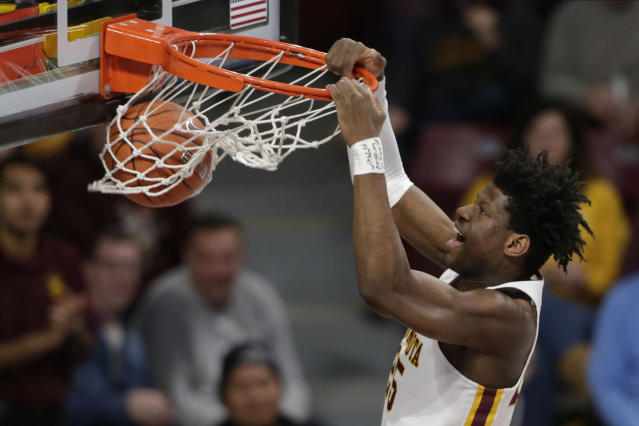 Minnesota center Daniel Orturu dunks against Clemson in the first half during an NCAA college basketball game Monday, Dec. 2, 2019, in Minneapolis. (AP Photo/Andy Clayton-King)