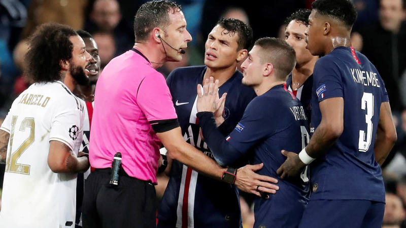 Players argue with the referee of the match during the UEFA Champions League Group A match between Real Madrid and Paris Saint-Germain at the Santiago Bernabeu Stadium in Madrid. (Photo by Burak Akbulut/Anadolu Agency via Getty Images)