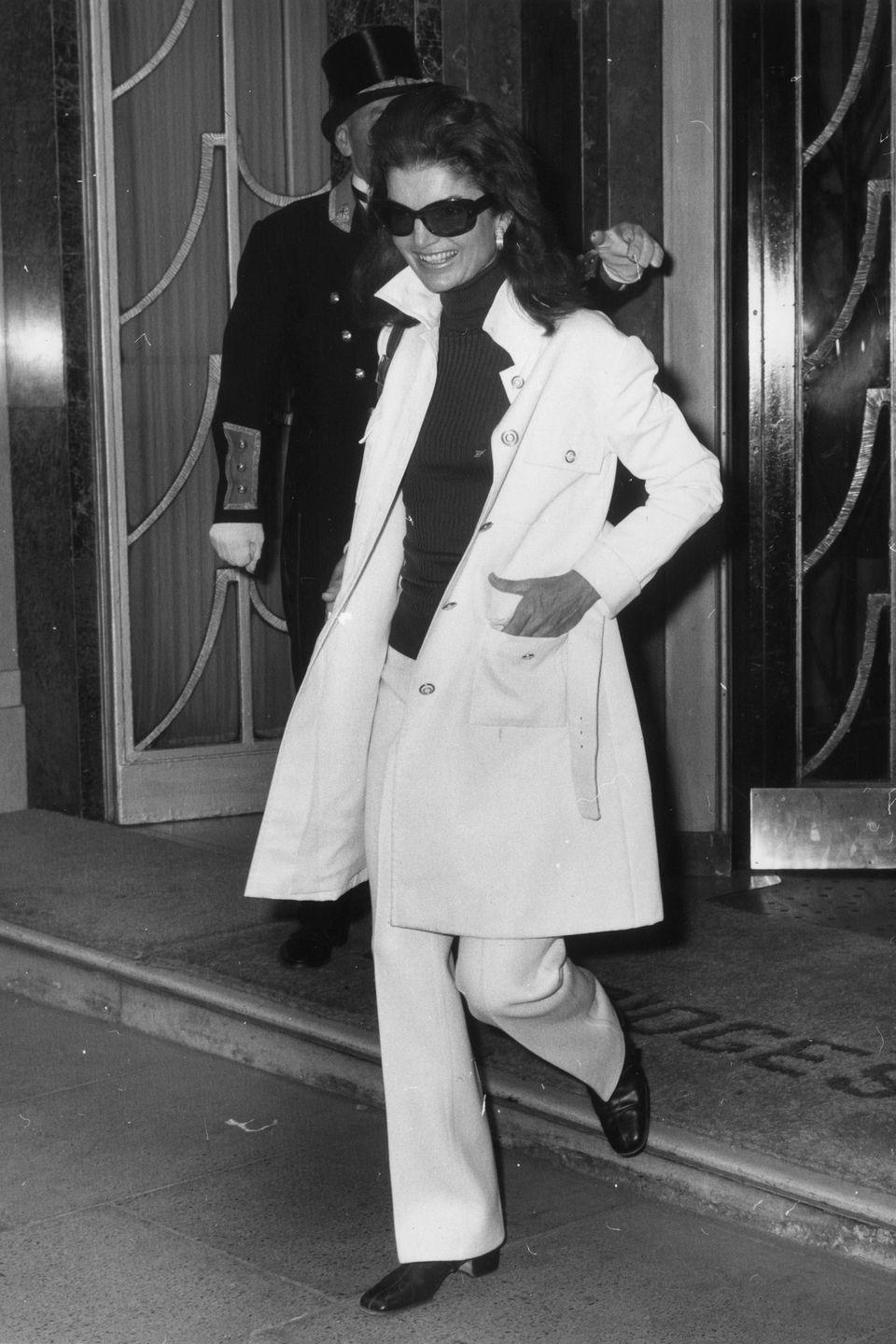 <p>Another iconic fashion moment, in a black turtleneck, trench and cool white trousers, while leaving the Claridges hotel in London in 1970.</p>