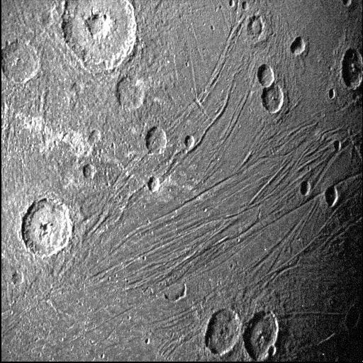 A slightly higher-resolution view of Ganymede's far side, illuminated by sunlight scattered from Jupiter's atmosphere, shows the surface