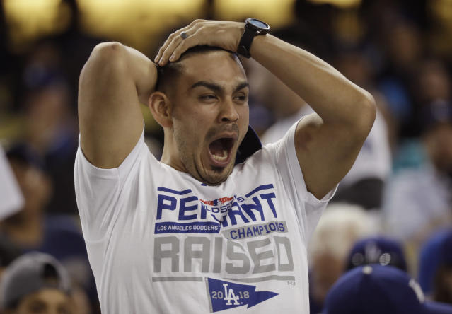 A fan yawns before the start of the 17th inning in Game 3 of the World Series baseball game between the Boston Red Sox and Los Angeles Dodgers on Friday, Oct. 26, 2018, in Los Angeles. (AP)