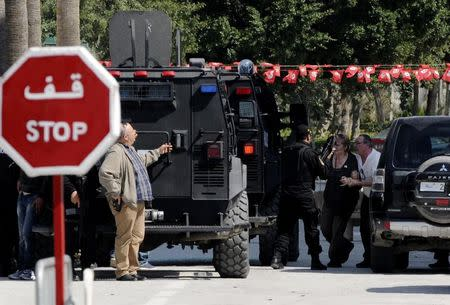 A tourist is helped to a vehicle after an attack by gunmen on Tunisia's national museum in Tunis March 18, 2015. REUTERS/Stringer