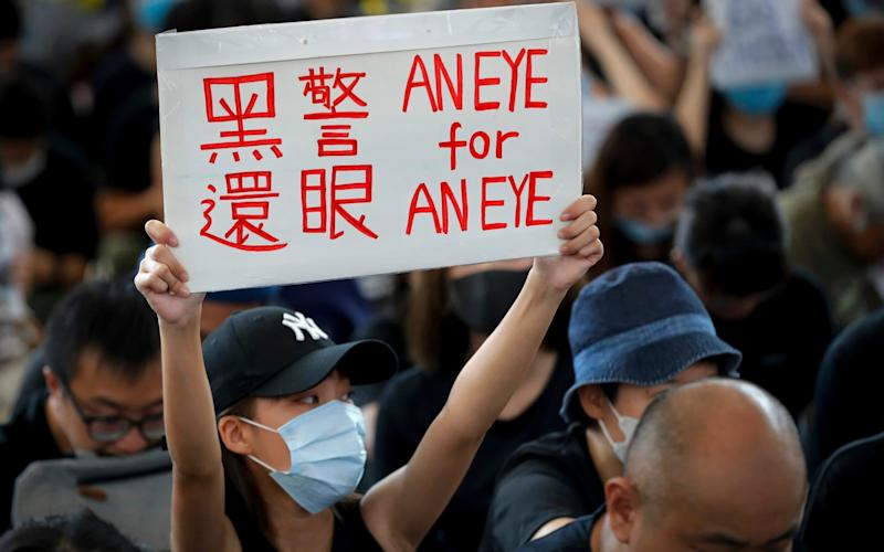 Hong Kong police said 5,000 people were at the airport protest - AP