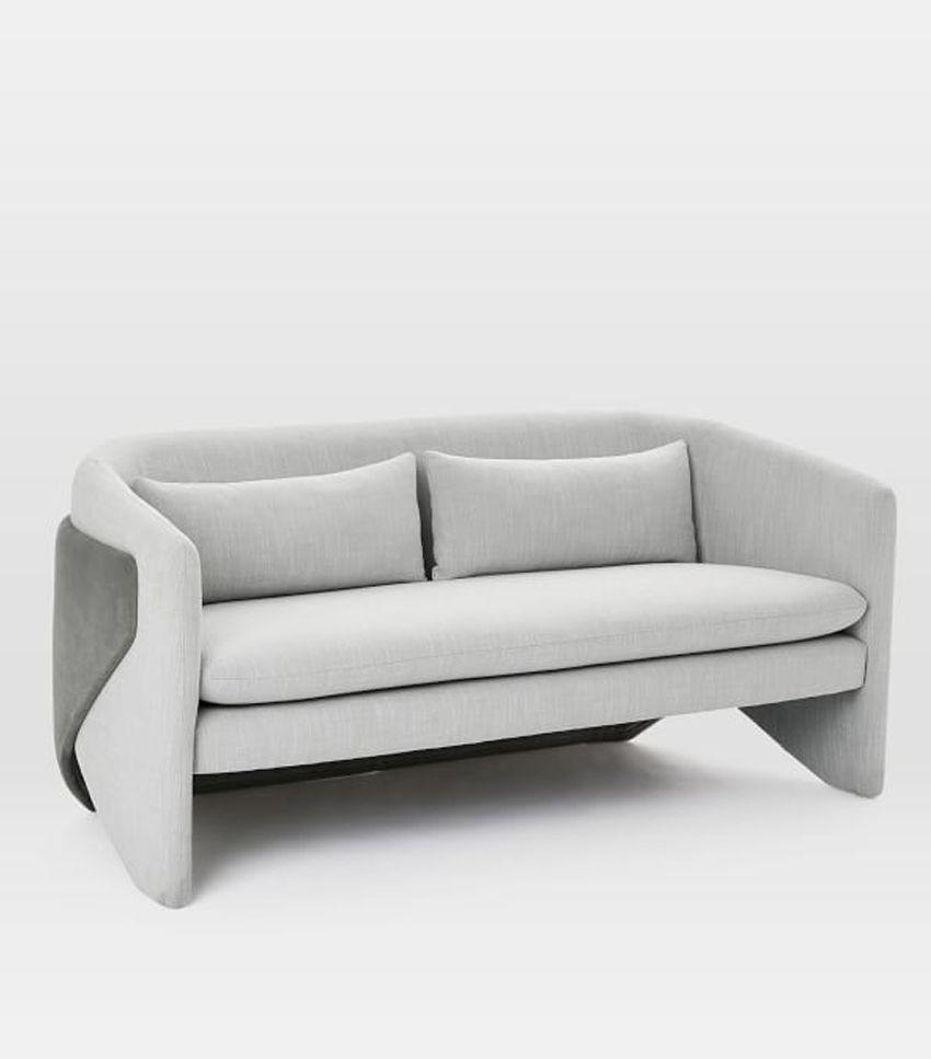This funky rounded sofa adds a serious cool factor to the '80s trend.