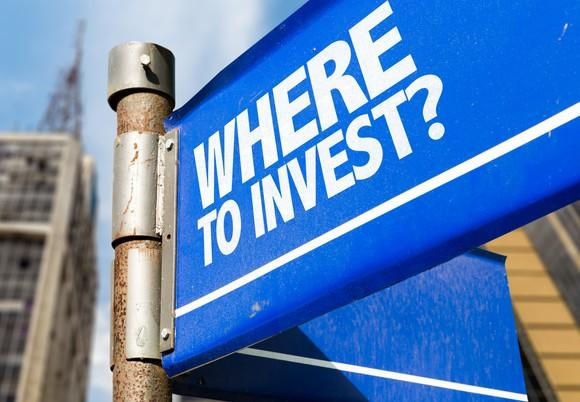 A blue street sign with the words Where to invest?