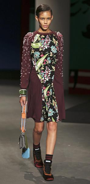 A model wears a creation for Prada men's Spring-Summer 2014 collection, part of the Milan Fashion Week, unveiled in Milan, Italy, Sunday, June 23, 2013. (AP Photo/Luca Bruno)