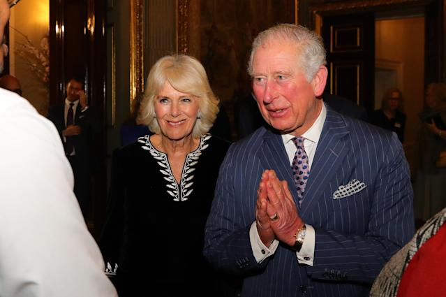 Charles used a namaste greeting on Monday instead of shaking hands. (Getty Images)