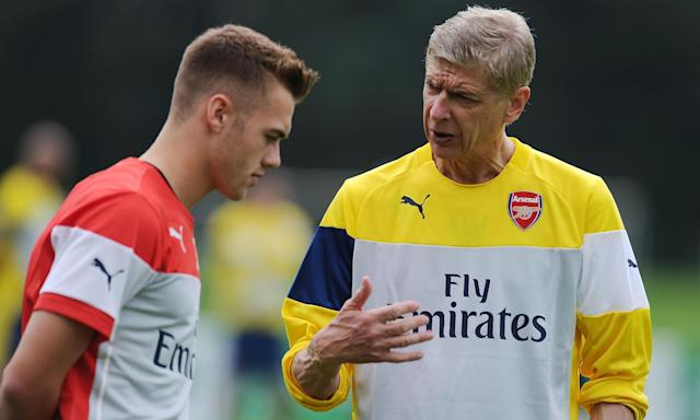Arsène Wenger talks to Calum Chambers in the summer of 2014 after signing the then 19-year-old defender from Southampton.