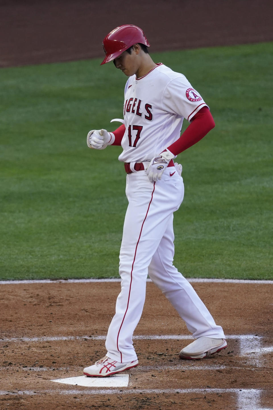 Los Angeles Angels starting pitcher Shohei Ohtani (17) crosses home plate after hitting a home run during the first inning of a baseball game against the Chicago White Sox Sunday, April 4, 2021, in Anaheim, Calif. (AP Photo/Ashley Landis)