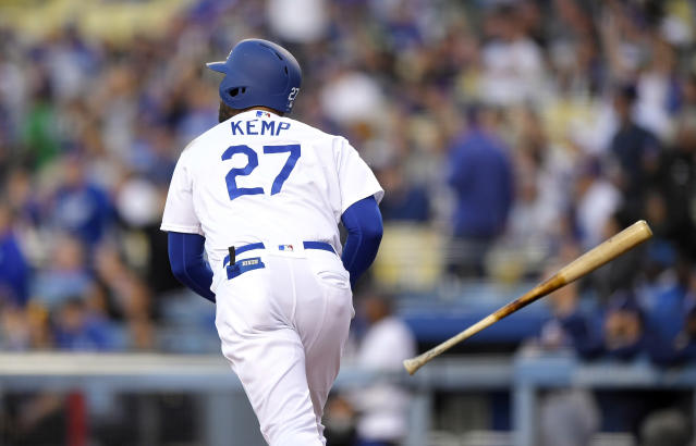 Los Angeles Dodgers' Matt Kemp tosses his bat as he hits a three-run home run during the first inning of a baseball game against the San Diego Padres, Friday, May 25, 2018, in Los Angeles. (AP Photo/Mark J. Terrill)