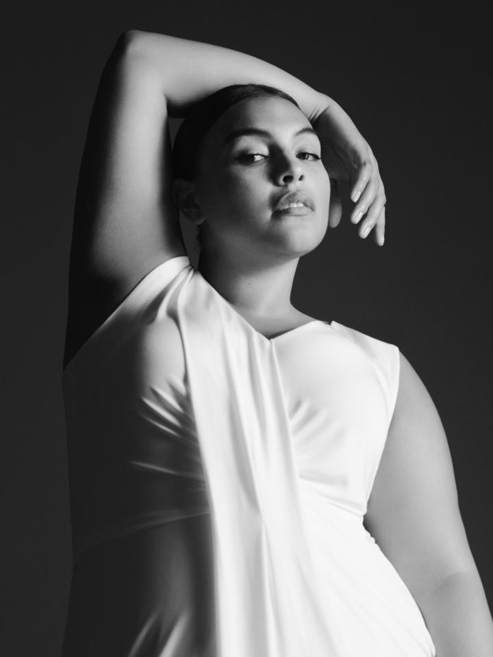 <p>Plus-sze model Paloma Elsesser shows off the drape-front V-neck dress in Chalk from the new Jason Wu x Eloquii collection. (Photo: Courtesy of Eloquii) </p>