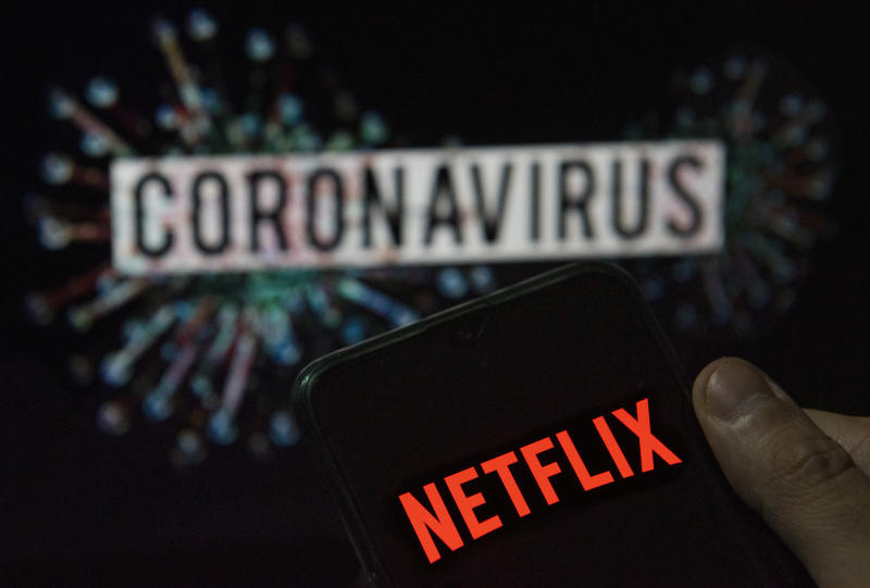 CHINA - 2020/03/22: In this photo illustration the American global on-demand Internet streaming media provider Netflix logo seen displayed on a smartphone with a computer model of the COVID-19 coronavirus on the background. (Photo Illustration by Budrul Chukrut/SOPA Images/LightRocket via Getty Images)