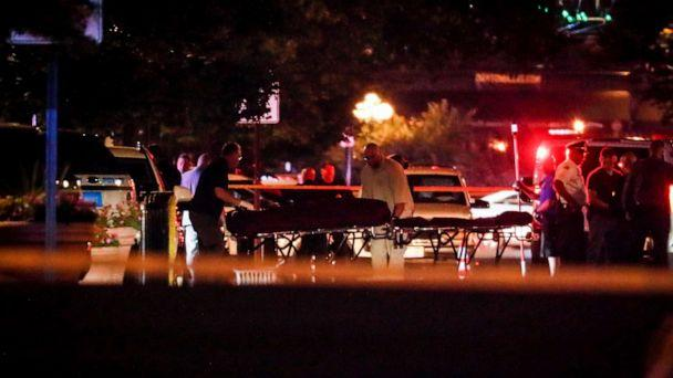PHOTO: Bodies are removed from at the scene of a mass shooting, Sunday, Aug. 4, 2019, in Dayton, Ohio. (John Minchillo/AP)