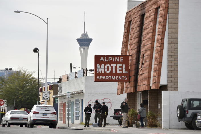 Investigators work at the scene of a three-story apartment complex fire early Saturday, Dec. 21, 2019 in Las Vegas. The fire was in first-floor unit of the Alpine Motel Apartments and its cause was under investigation, the department said. Authorities say multiple fatalities were reported and many more were injured. (AP Photo/David Becker)