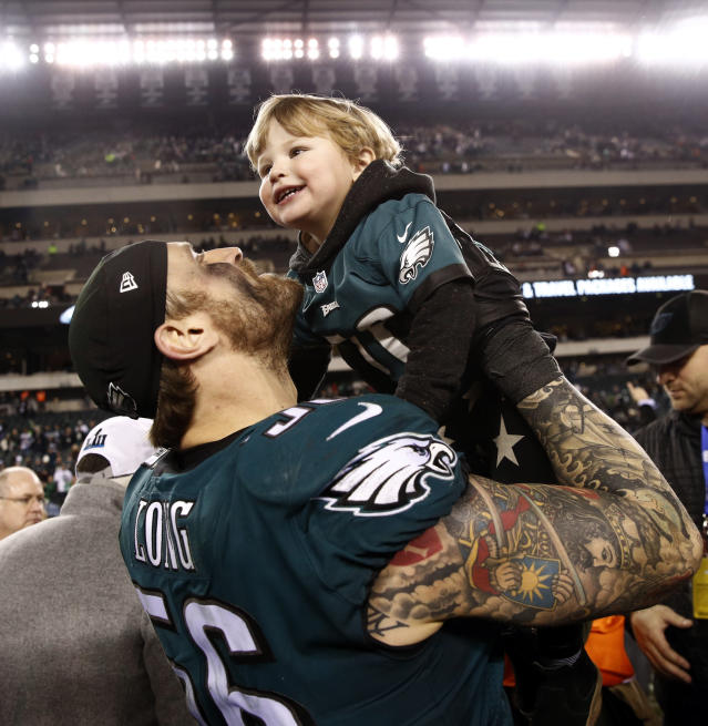 <p>Philadelphia Eagles' Chris Long celebrates with his family after the NFL football NFC championship game against the Minnesota Vikings Sunday, Jan. 21, 2018, in Philadelphia. The Eagles won 38-7 to advance to Super Bowl LII. (AP Photo/Patrick Semansky) </p>
