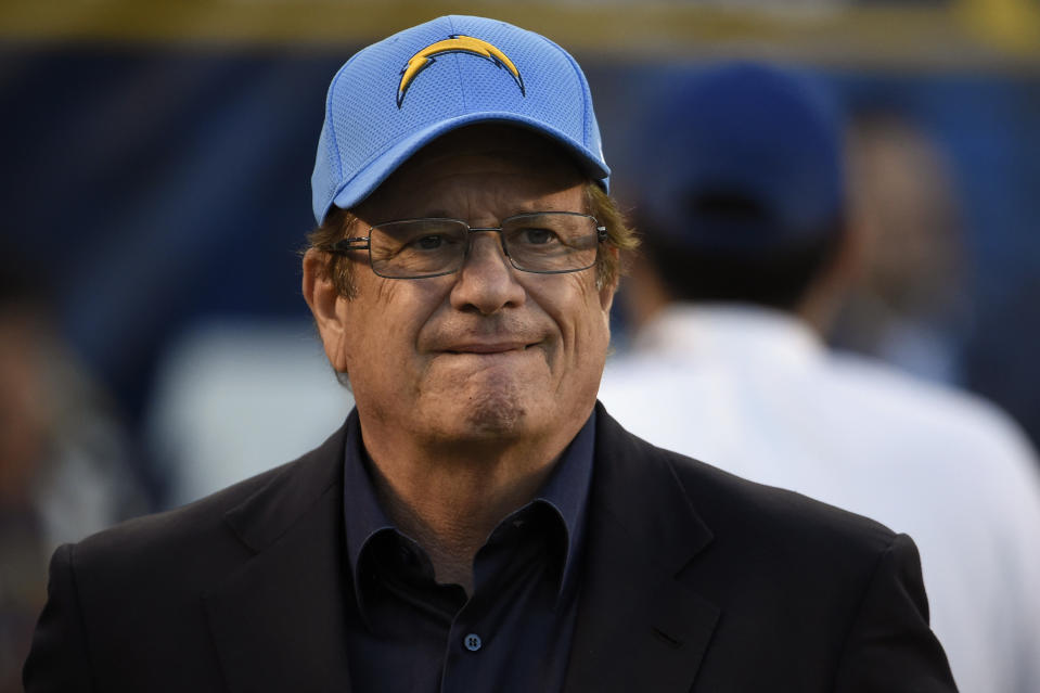 FILE - In this Dec. 18, 2016, file photo, San Diego Chargers team president and CEO Dean Spanos looks on during the second half of an NFL football game against the Oakland Raiders, in San Diego. The Chargers are moving to Los Angeles, where they will join the recently relocated Rams in giving the nation's second-largest media market two NFL teams for the first time in decades. The announcement was made Thursday, Jan. 12, 2017.(AP Photo/Denis Poroy, File)
