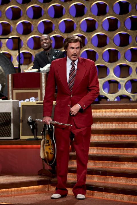 """In this March 28, 2012 photo released by Team Coco, Will Ferrell portrays broadcaster Ron Burgundy during an appearance on """"Conan,"""" in Burbank, Calif.  Ferrell dressed as the popular character from """"Anchorman: The Legend of Ron Burgundy,"""" and after performing a flute solo, he announced that there would be a sequel to the 2004 film. (AP Photo/Team Coco, Meghan Sinclair)"""