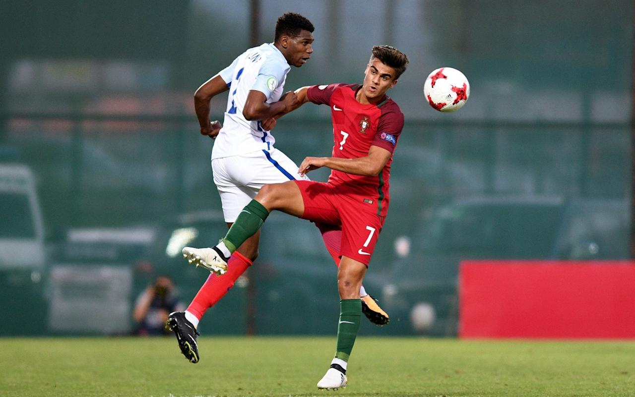 England won the European Under-19 Championship title for the first time in their history after beating Portugal 2-1 in Saturday's final in Georgia. Aston Villa defender Easah Suliman headed the Young Lions in front early in the second half after a free-kick Mason Mount had hit the post. A sliced own-goal from Chelsea right-back Dujon Sterling saw Portugal level before the hour. Keith Downing's side, though, secured a memorable victory when Manchester City forward Lukas Nmecha swept in after 68 minutes following a powerful run from Mount down the right. England finished the match with 10 men after Fulham's Tayo Edun collected a second yellow card in the 86th minute, but it was not enough to deny them. Easah Suliman put England in front Credit: Getty images The triumph follows on from England's success at the U20 World Cup and Toulon Tournament, while they also reached the final of the European U17 competition and saw the U21s make the semi-finals of their European Championships in Poland last month, losing on penalties to Germany. The opening exchanges at the Tengiz Burjanadze Stadium in Gori were cagey. Just before the half-hour, Nmecha - whose stoppage-time goal against the Czech Republic had secured England's place in the final - got away down the right and fed City team-mate Isaac Buckley-Ricketts who set up Mount, but the Chelsea man saw his shot blocked. Portugal went close when Domingos Quina, who plays his club football in England at West Ham, dragged a left-foot side wide. Chelsea's Dujon Sterling scored an own goal that levelled the tie  Credit: Getty images Buckley-Ricketts shot over following a positive run from Nmecha before Ryan Sessegnon pulled a shot across the face of goal. At the start of the second half, England goalkeeper Aaron Ramsdale had to be alert when he collected a shot from Mesaque Dju out on the right. England went ahead in the 50th minute. Get in! #younglionspic.twitter.com/jXu4AKANWK— England (@England) July 15, 2017 Midfielder Mount whipped a 25-yard free-kick up over the wall, which hit the base of the right-hand post and bounced back into the six-yard box where Suliman nodded it into an empty net. Portugal, though, were not behind for long. Dju should have equalised when the ball dropped to him at the far post following a corner, but he could only lash his shot high over the crossbar from two yards out. The equaliser soon followed in the 56th minute. #U20WC@TournoiToulon#U19EUROpic.twitter.com/i2FdSDeMMW— England (@England) July 15, 2017 Abdu Conte sent over a deep ball from the left flank, which drifted through towards the far post, where Sterling sliced it past team-mate Ramsdale. England had grown in confidence during the tournament after topping Group B following a 4-1 win over Germany in Tbilisi and a dramatic victory against the Czechs on Wednesday. However, Downing's side were in danger of losing their composure as Quina saw his goalbound effort saved. England, though, slowly regrouped and regained the lead in the 68th minute. Congratulations lads. Great summer for the young @England teams https://t.co/CySf8JsVFj— Wayne Rooney (@WayneRooney) July 15, 2017 Mount burst away down the right and charged into the penalty area before clipping the ball back across to Nmecha, who swept into an unguarded net. Porto forward Rui Pedro dragged an angled shot wide from the edge of the England box as Portugal sought an equaliser. England were reduced to 10 men with five minutes left when Edun collected a second caution followed by a red card for a trip on Madi Queta in the centre-circle. Miguel Luis flashed an angled drive into the side netting and substitute Josh Da Silva, the Arsenal midfielder, cleared a header off the line during five minutes of added time as England held out for victory.